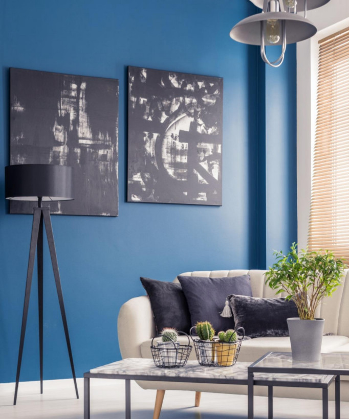 interior residence living room with sofa and table with walls painted with blue KEIM mineral paint