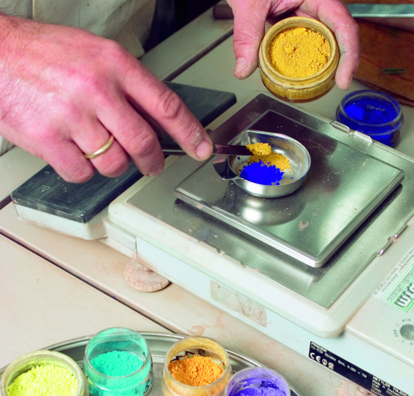 technician working with paint colors in laboratory
