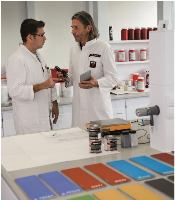 two lab technicians in laboratory with KEIM mineral paint samples